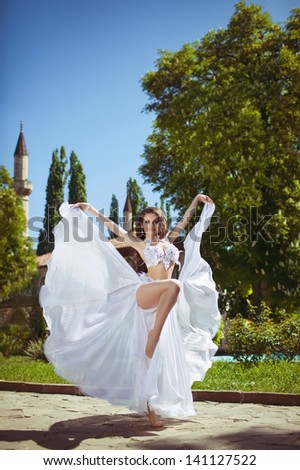 Beautiful woman bride bellydancer sexy belly dancer in carnival shining costume makeup and jewelry.  gorgeous brunette turkish exotic star of bellydance. Girl bollywood dancer. Arabian bellydancer - stock photo