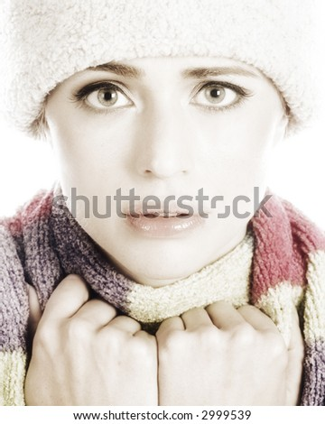 Beautiful Woman Bundled up in a Winter Hat and Scarf.  Isolated on a White Background.