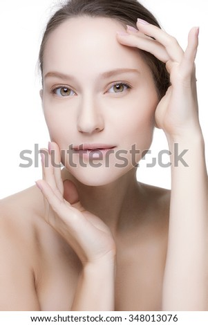 Beautiful woman cares for the skin - posing at studio isolated on white background. - stock photo