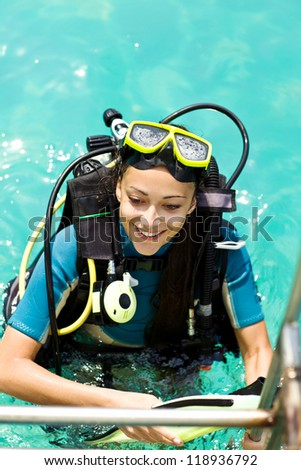 beautiful woman checking diving. dive equipment - stock photo