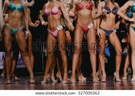 beautiful woman chest and flat tummies. competition fitness bikini - stock photo
