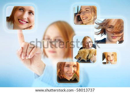 Beautiful woman chooses positive images of herself as a concept for good self-image. - stock photo