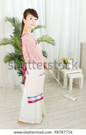 Beautiful woman cleaning in the room. Portrait of asian woman