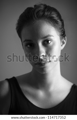 Beautiful woman close up portrait. Black and white image. - stock photo