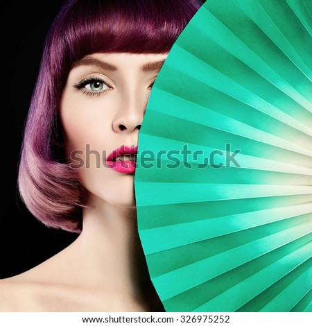 Beautiful Woman. Colorful Coloring Hair, Makeup and Green Paper Background. - stock photo