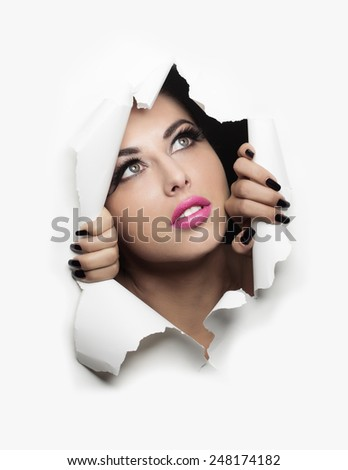 beautiful woman coming out of a white background - stock photo