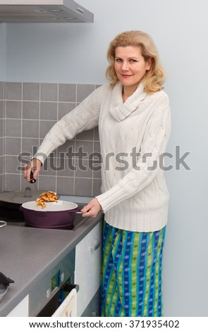 Beautiful woman cooking healthy food at  home kitchen  - stock photo