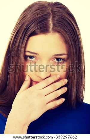 Beautiful woman covering her mouth. - stock photo