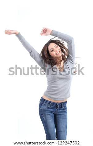 Beautiful woman dancing happy on a white isolated background - stock photo