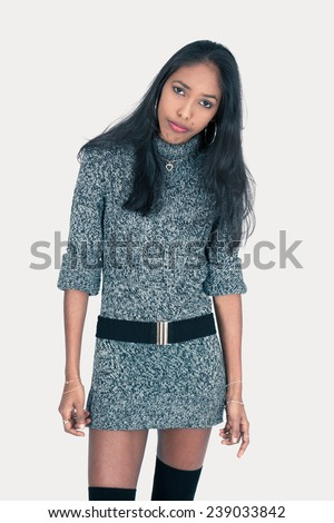 Beautiful woman doing different expressions in different sets of clothes: bored - stock photo