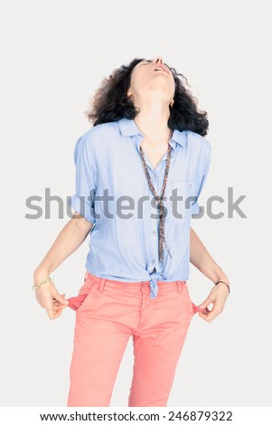 Beautiful woman doing different expressions in different sets of clothes: empty pockets - stock photo