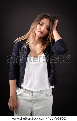 Beautiful woman doing different expressions in different sets of clothes: headache - stock photo