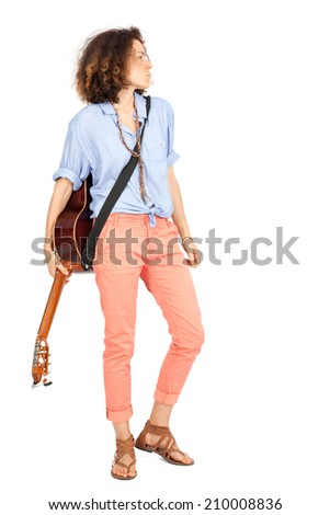 Beautiful woman doing different expressions in different sets of clothes: posing with guitar - stock photo