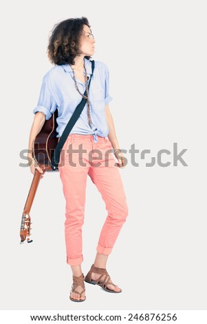 Beautiful woman doing different expressions in different sets of clothes: posing with guitar