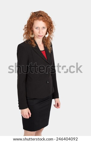 Beautiful woman doing different expressions in different sets of clothes: sadness - stock photo