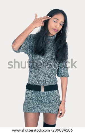 Beautiful woman doing different expressions in different sets of clothes: suicide - stock photo