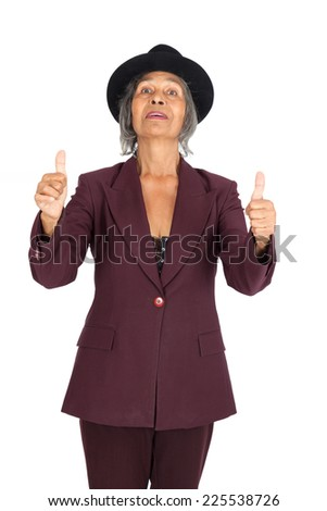 Beautiful woman doing different expressions in different sets of clothes: thumbs up - stock photo