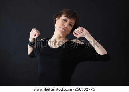 Beautiful woman doing different expressions in different sets of clothes: wake up - stock photo