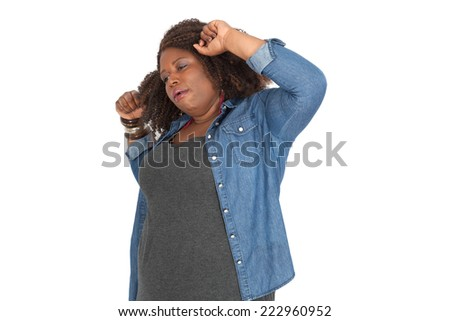 Beautiful woman doing different expressions in different sets of clothes: waking up - stock photo