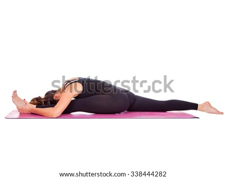 Beautiful woman doing Hanumanasana variation pose on yoga class. Studio shot.