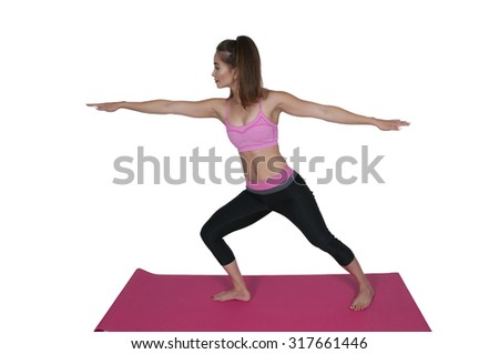Beautiful woman doing her Yoga stance exercises - stock photo