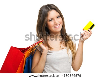 Beautiful woman doing shopping and showing a credit card