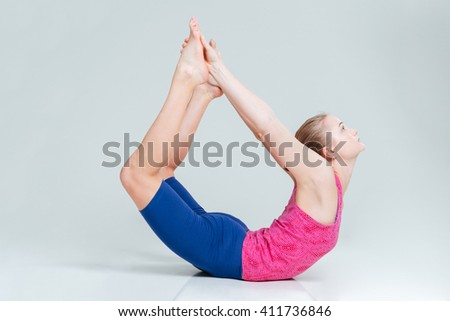 Beautiful woman doing yoga exercise isolated on a white background - stock photo