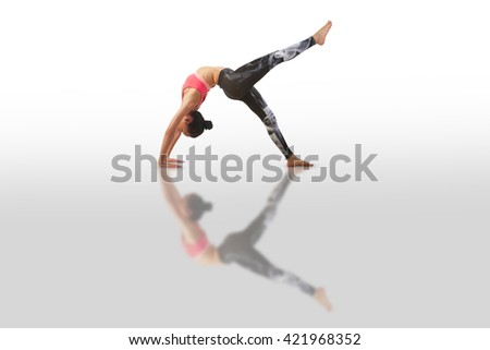 beautiful woman doing yoga on a white background - stock photo