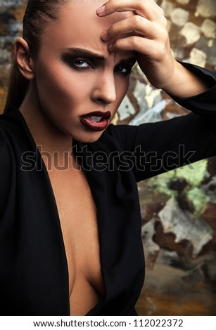 Beautiful woman dramatic portrait. Vogue style photo.
