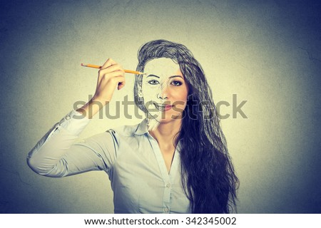 beautiful woman drawing self portrait with pencil  - stock photo