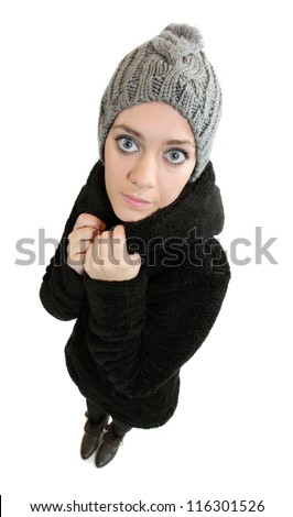 Beautiful woman dressed in knitted hat and fur coat. - stock photo