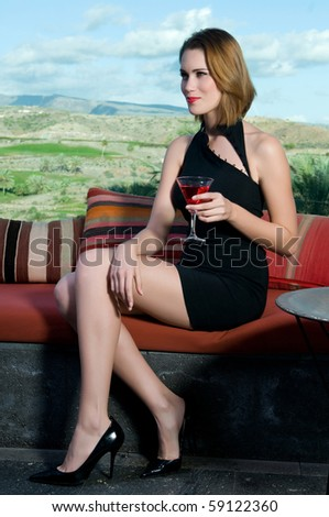 beautiful woman drinking a cocktail - stock photo