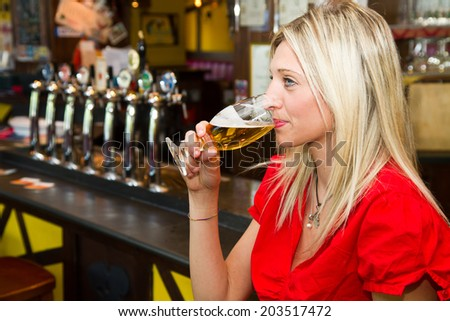 Beautiful woman drinking beer