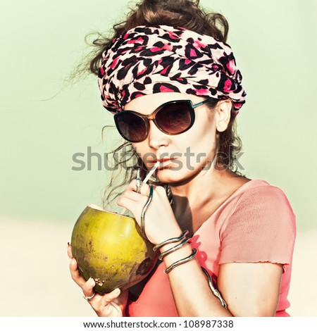 Beautiful woman drinking coconut outdoor