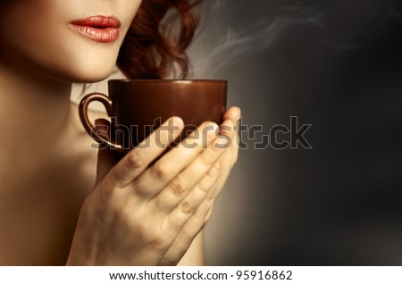 Beautiful Woman Drinking Coffee. Space for text - stock photo