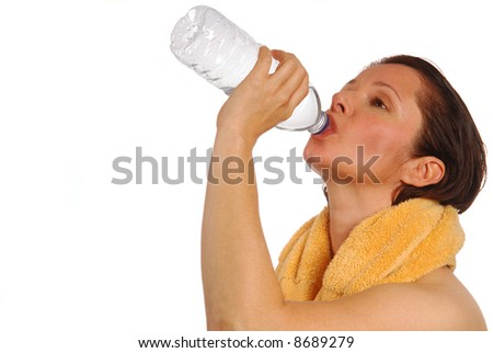 Beautiful woman drinking from a water bottle after a workout - stock photo
