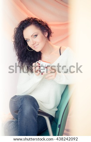 beautiful woman drinking tea or coffee