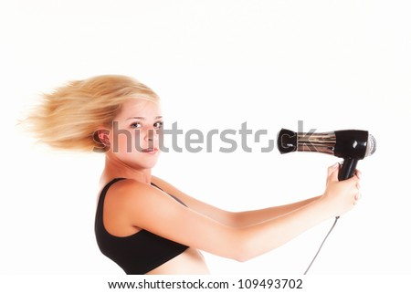Beautiful woman drying her hair with hairdryer isolated on white - stock photo