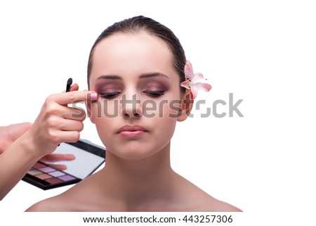 Beautiful woman during make-up cosmetics session isolated on whi - stock photo