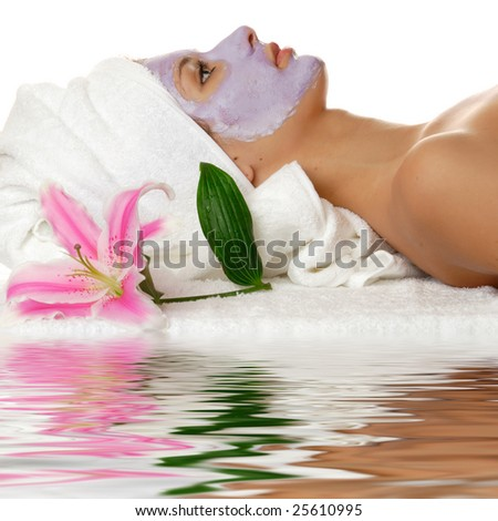 Beautiful woman during the spa treatment isolated on white with water reflection - stock photo