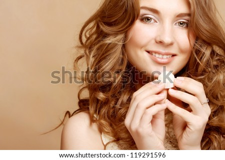 Beautiful woman eating candy - stock photo