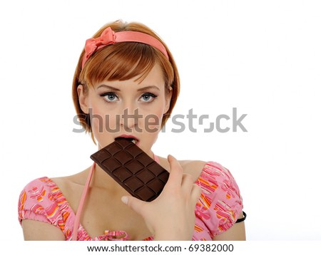 beautiful woman eating chocolate bar. isolated on white background