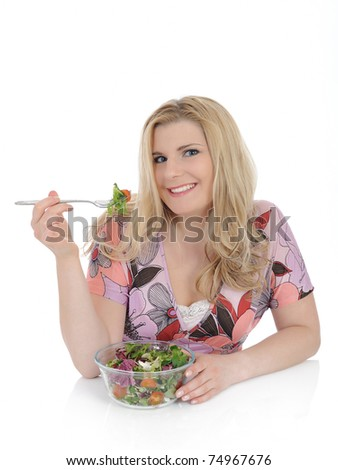 beautiful woman eating green vegetable salad. isolated on white - stock photo
