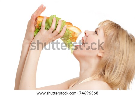 beautiful woman eating hot dog on a white background - stock photo