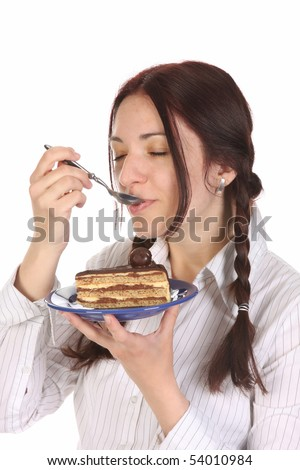 Beautiful woman eating piece of cake on white background
