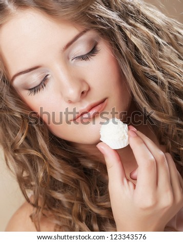 beautiful woman eating sweet candy - stock photo