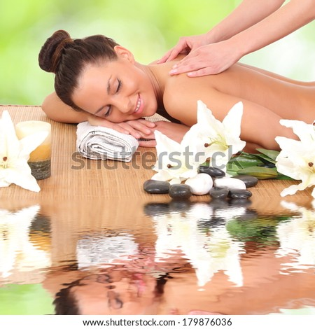 Beautiful woman enjoying a massage therapy - stock photo