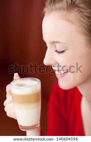 beautiful woman enjoying caffee latte in a coffee shop - stock photo