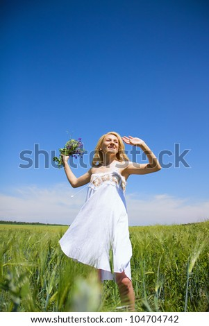 Beautiful woman enjoying in the nature and fresh air.
