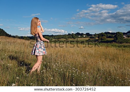 Beautiful woman enjoying in the nature and fresh air. - stock photo
